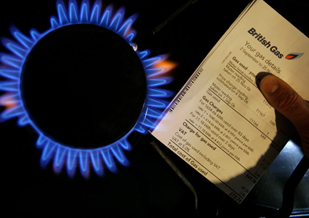 A British Gas bill is displayed by a gas ring on a cooker in this photo illustration in London, Thursday, Feb. 21, 2008. British Gas has reported annual profits of 571m, up from 95m in 2006.
