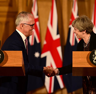 Australian Prime Minister, Malcolm Turnbull and Britain's Prime Minister Theresa May (R) shake hands at a press conference in 10 Downing Street in central London on July 10, 2017.