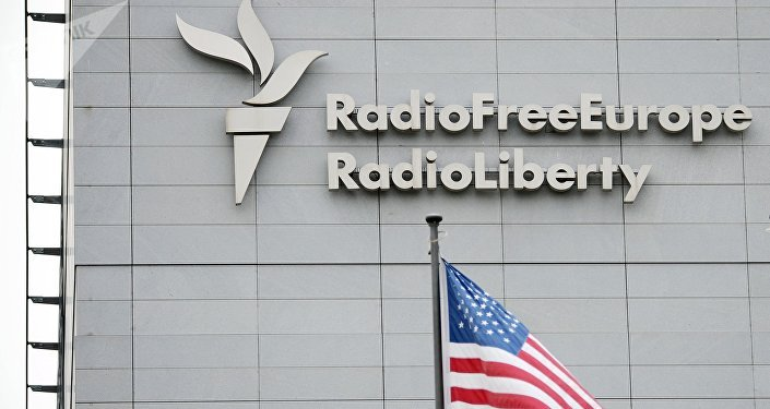 A sign on the headquarters of Radio Free Europe / Radio Liberty international broadcasting organization in Prague