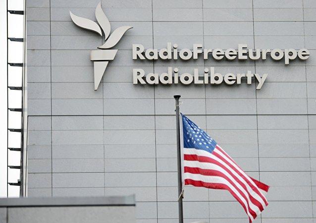 A sign on the headquarters of Radio Free Europe / Radio Liberty international broadcasting organization in Prague