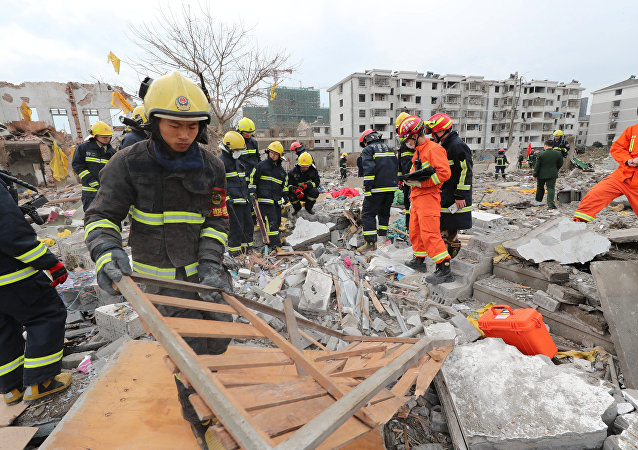 Rescue workers work at the site of a blast in Ningbo, Zhejiang province, China November 26, 2017