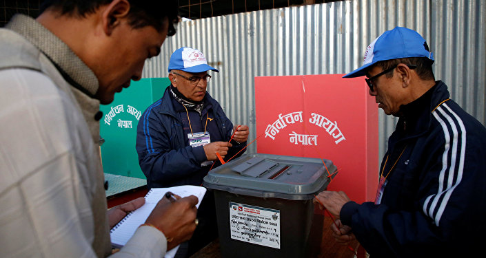 Officers from election commission seal a ballot box during the parliamentary and provincial elections at Chautara in Sindhupalchok District November 26, 2017