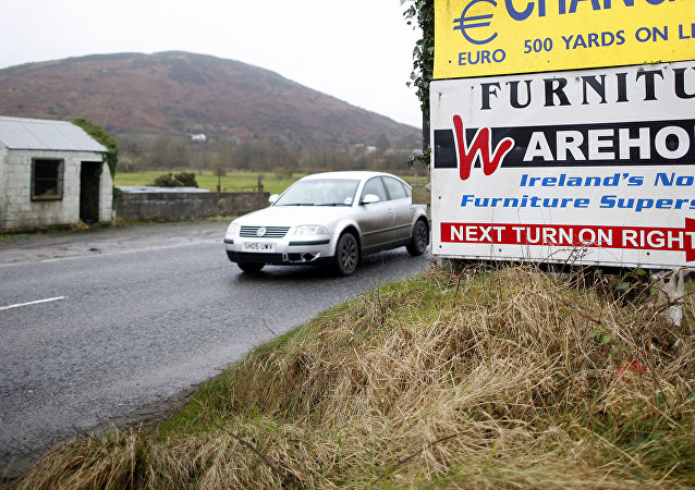 A motorist crosses over the border from the Irish Republic into Northern Ireland near the town of Jonesborough, Northern Ireland, Monday, Jan. 30, 2017