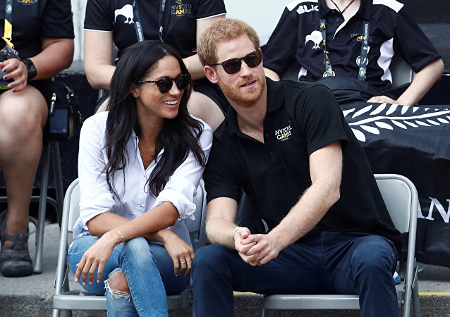 Britain's Prince Harry (R) sits with girlfriend actress Meghan Markle to watch a wheelchair tennis event during the Invictus Games in Toronto, Ontario, Canada September 25, 2017
