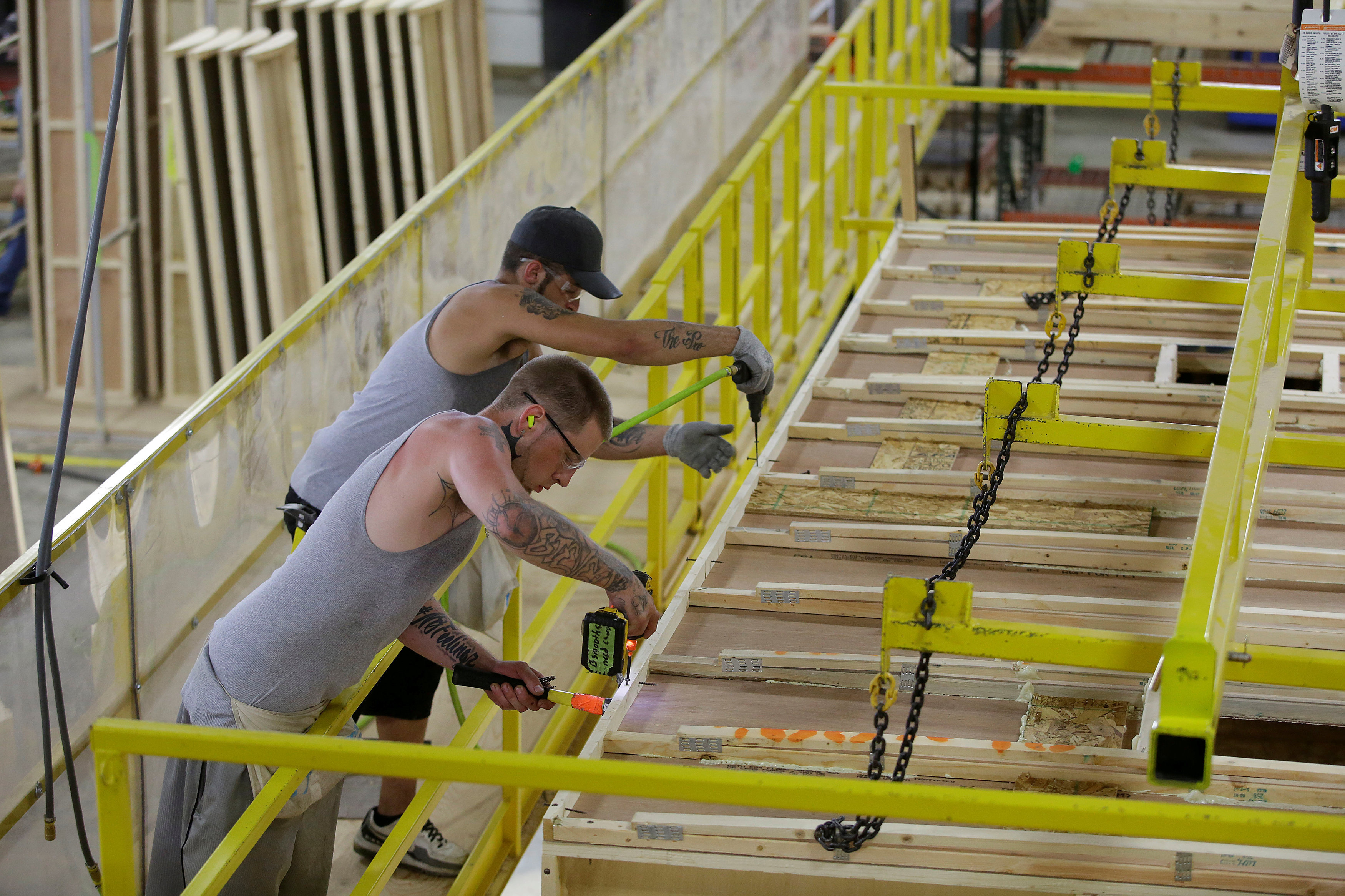 Workers build the roof of a single axel towable Pioneer traditional recreational vehicle at the Thor Industries Heartland RV Assembly Plant in Elkhart, Indiana, U.S. on June 13, 2017