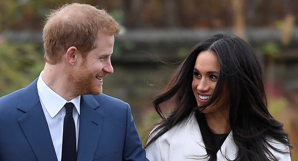 Britain's Prince Harry poses with Meghan Markle in the Sunken Garden of Kensington Palace, London, Britain