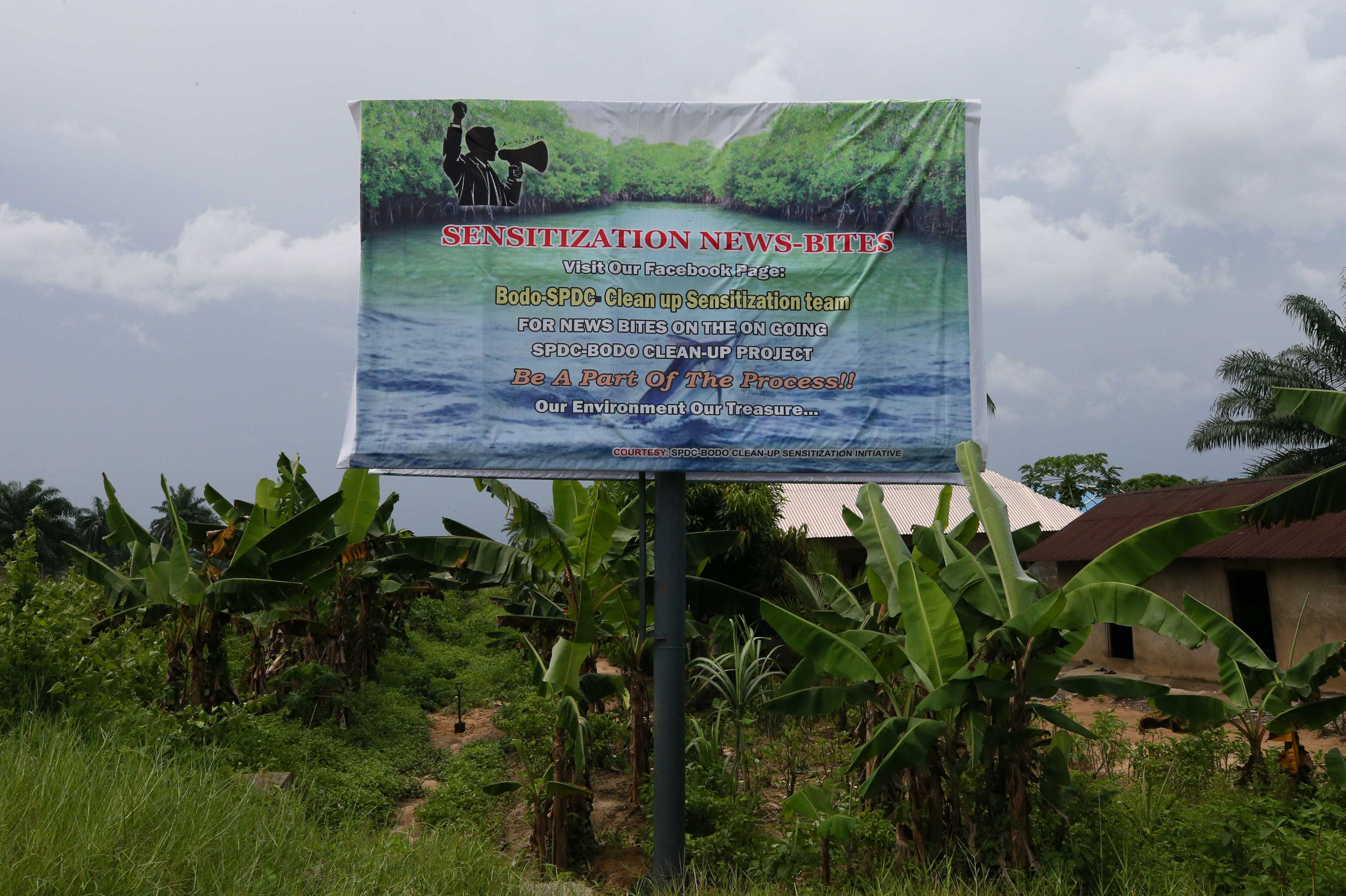 A signboard announces the clean-up by Shell-SPDC in Bodo Rivers State, Nigeria November 1, 2017