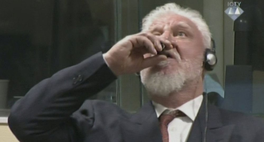 Bosnian Croat war criminal 'drinks poison' at Hague hearing