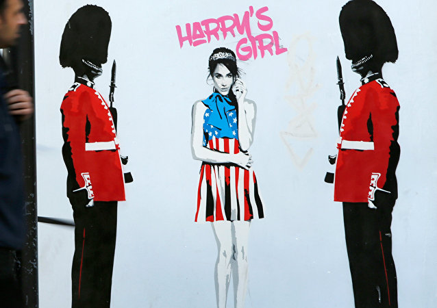 People walk past a piece of street art by Pegasus depicting Meghan Markle in London, Britain, November 28, 2017.