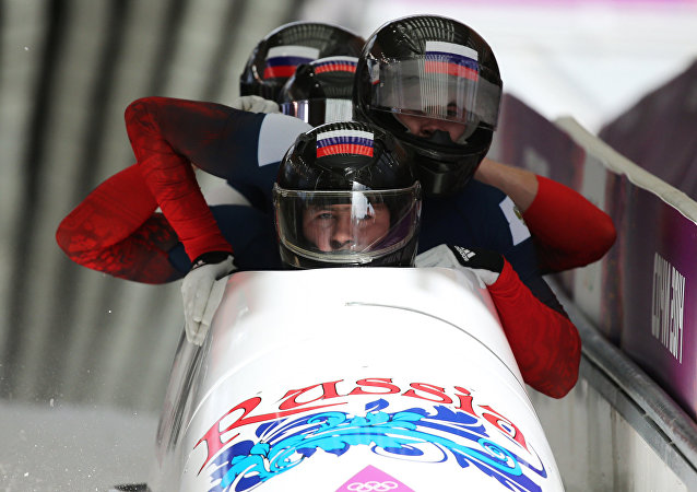 Alexander Kasyanov, Ilvir Khuzin, Maxim Belugin and Alexey Pushkarev (Russia) at the finish of the third heat of the four-man bobsleigh competition at the XXII Olympic Winter Games in Sochi. (File)