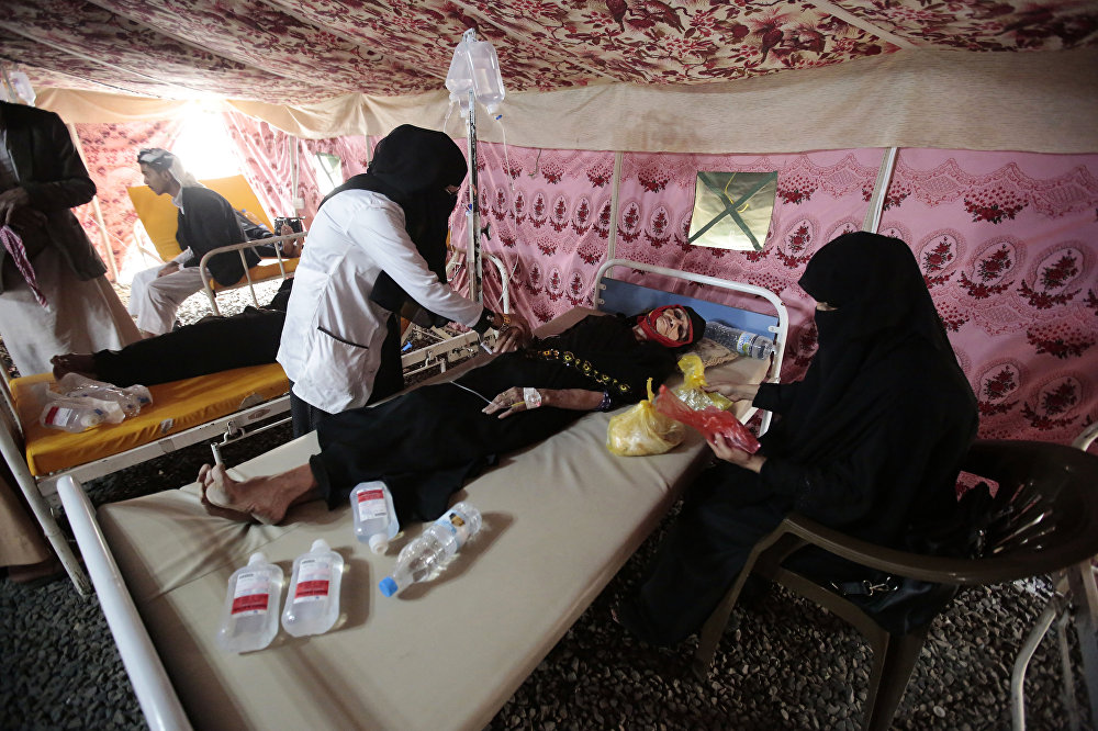 In this photo taken on Thursday, Jun 29, 2017, an elderly woman is treated for suspected cholera infection in a tent at a hospital in Sanaa, Yemen, Saturday, Jul. 1, 2017