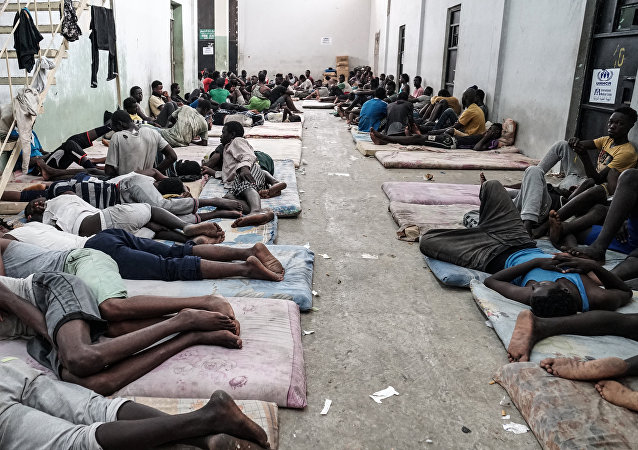 Illegal immigrants are seen at a detention centre in Zawiyah, 45 kilometres west of the Libyan capital Tripoli, on June 17, 2017