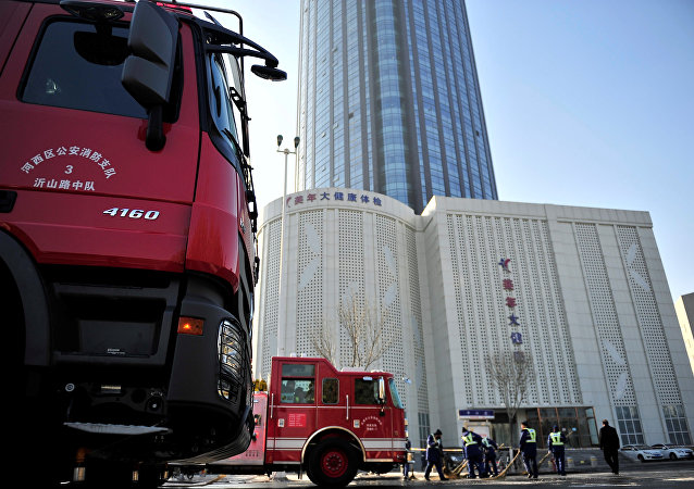 Fire trucks are seen outside a skyscraper after a fire broke out around 4 a.m. on the 38th floor of a serviced apartment, in Tianjin, China December 1, 2017