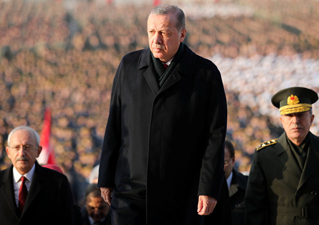 Turkish President Tayyip Erdogan attends a ceremony as he is flanked by top officials and army officers at the mausoleum of Mustafa Kemal Ataturk, marking Ataturk's death anniversary, in Ankara, Turkey November 10, 2017.