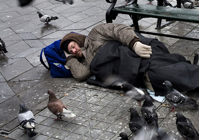 This is a January 2012 file photo of a homeless man sleeping in Townhall Square in Copenhagen
