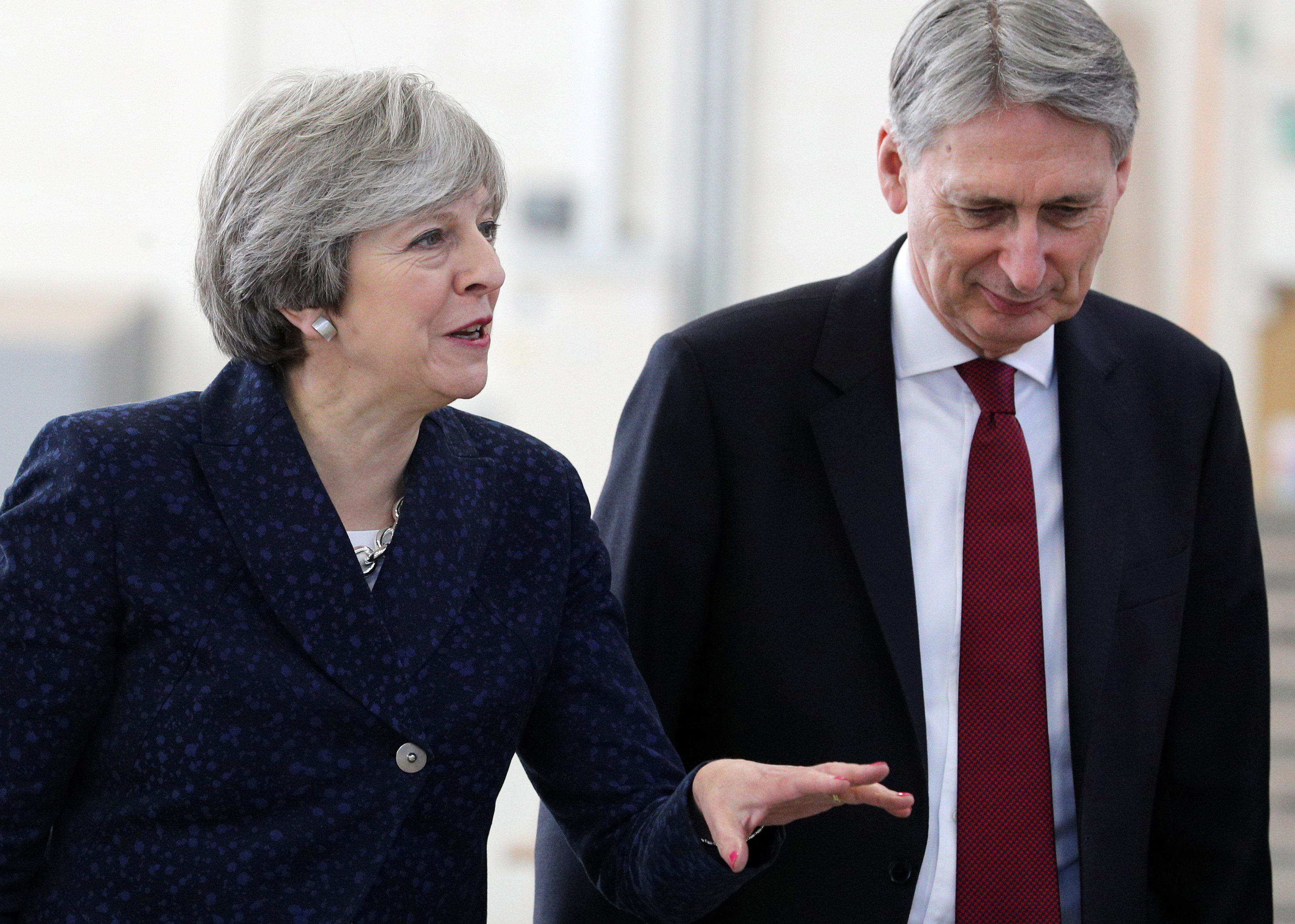 Britain's Prime Minister Theresa May and Chancellor of the Exchequer Philip Hammond visit Leeds College of Building, Leeds, Britain, November 23, 2017