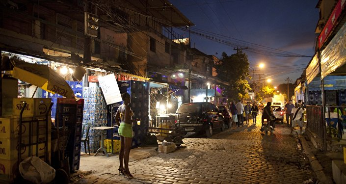 In this photo taken May 25, 2011, A sex worker waits for customers at the Vila Mimosa prostitution zone in Rio de Janeiro, Brazil