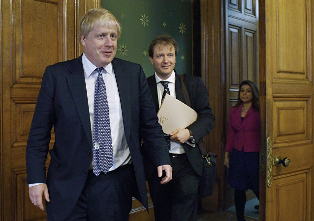 Britain's Foreign Secretary Boris Johnson (L) meets with Richard Ratcliffe, the husband of British-Iranian woman Nazanin Zaghari-Ratcliffe who is jailed in Iran, at the Foreign and Commonwealth Office in London on November 15, 2017
