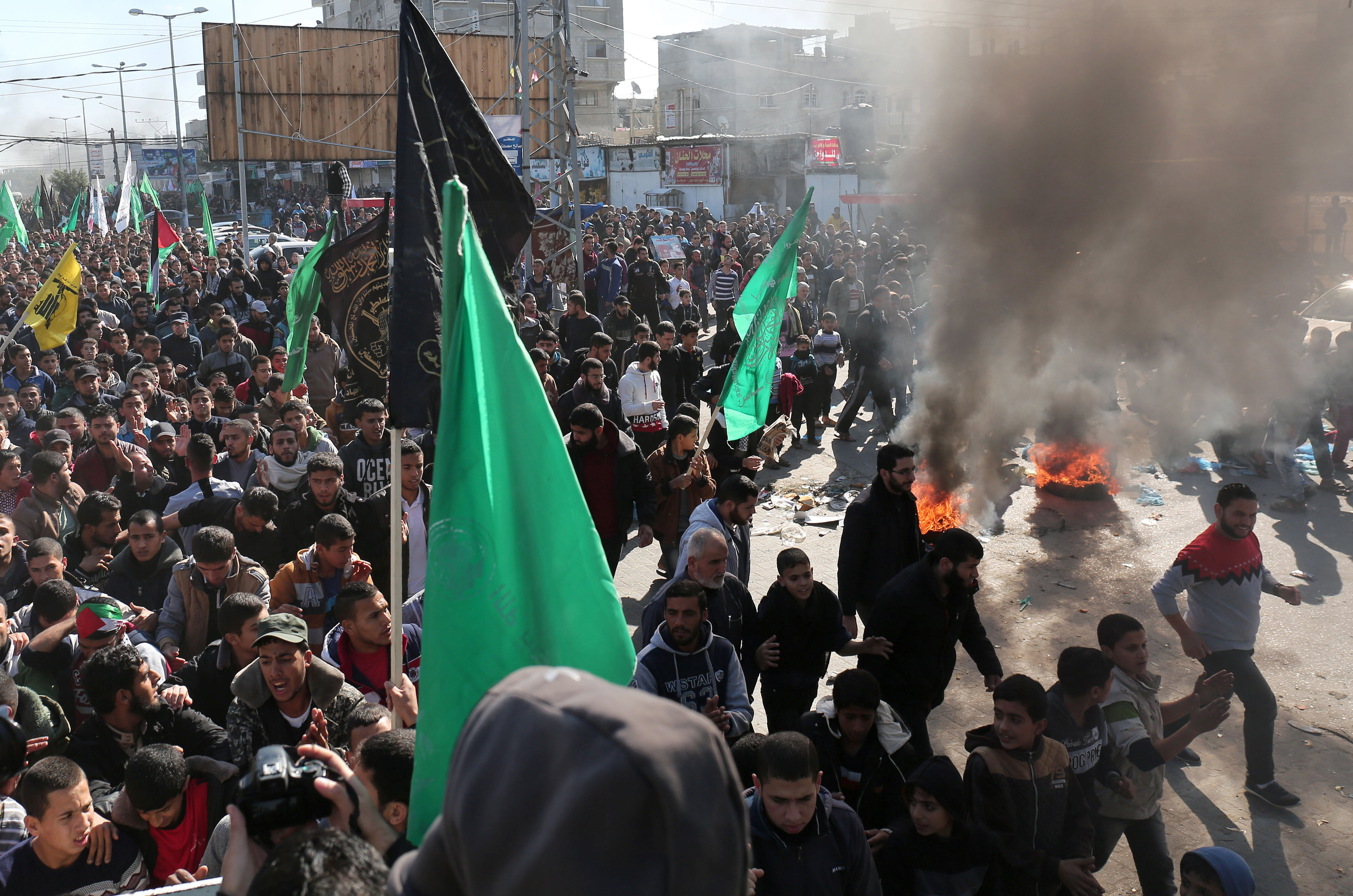 Palestinian protesters burn tyres during a demonstration in the southern Gaza Strip town of Rafah on December 8, 2017 against US President Donald Trump's latest decision to recognise Jerusalem as the capital of Israel