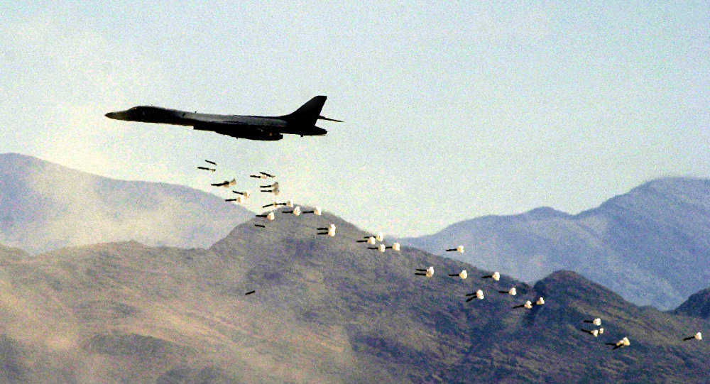 A B1-B bomber drops live bombs at the Nevada Test and Training Range