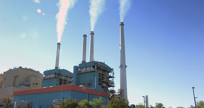 smoke rises from the Colstrip Steam Electric Station, a coal burning power plant in Colstrip, Mont.
