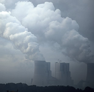 A brown coal power plant photographed in morning fog near Hoeningen, Germany, Monday, Nov. 6, 2017