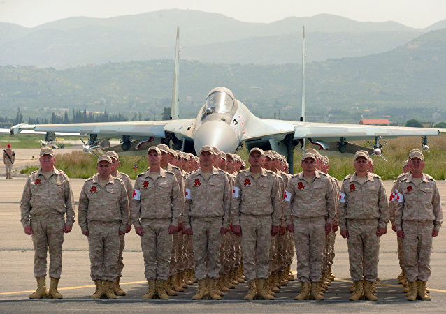 Servicemen are seen here at the Russian air base in Khmeimim during a military parade marking the 72nd anniversary of Victory in the 1941-45 Great Patriotic War. File photo