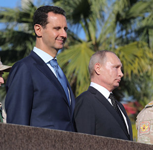 President of Russia Vladimir Putin, President of Syria Bashar al-Assad (left) and Defense Minister Sergei Shoigu at the Hmeymim Air Base in Syria