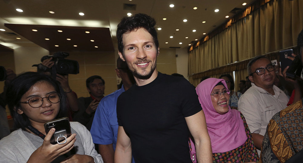 Telegram co-founder Pavel Durov, center, smiles as he leaves after a press conference following his meeting with Indonesian Communication and Information Minister Rudiantara in Jakarta, Indonesia Tuesday, Aug. 1, 2017