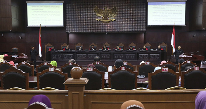 Judges read their verdict on the case of a petition seeking to make gay sex and sex outside marriage illegal during a hearing at the Constitutional Court in Jakarta, Indonesia