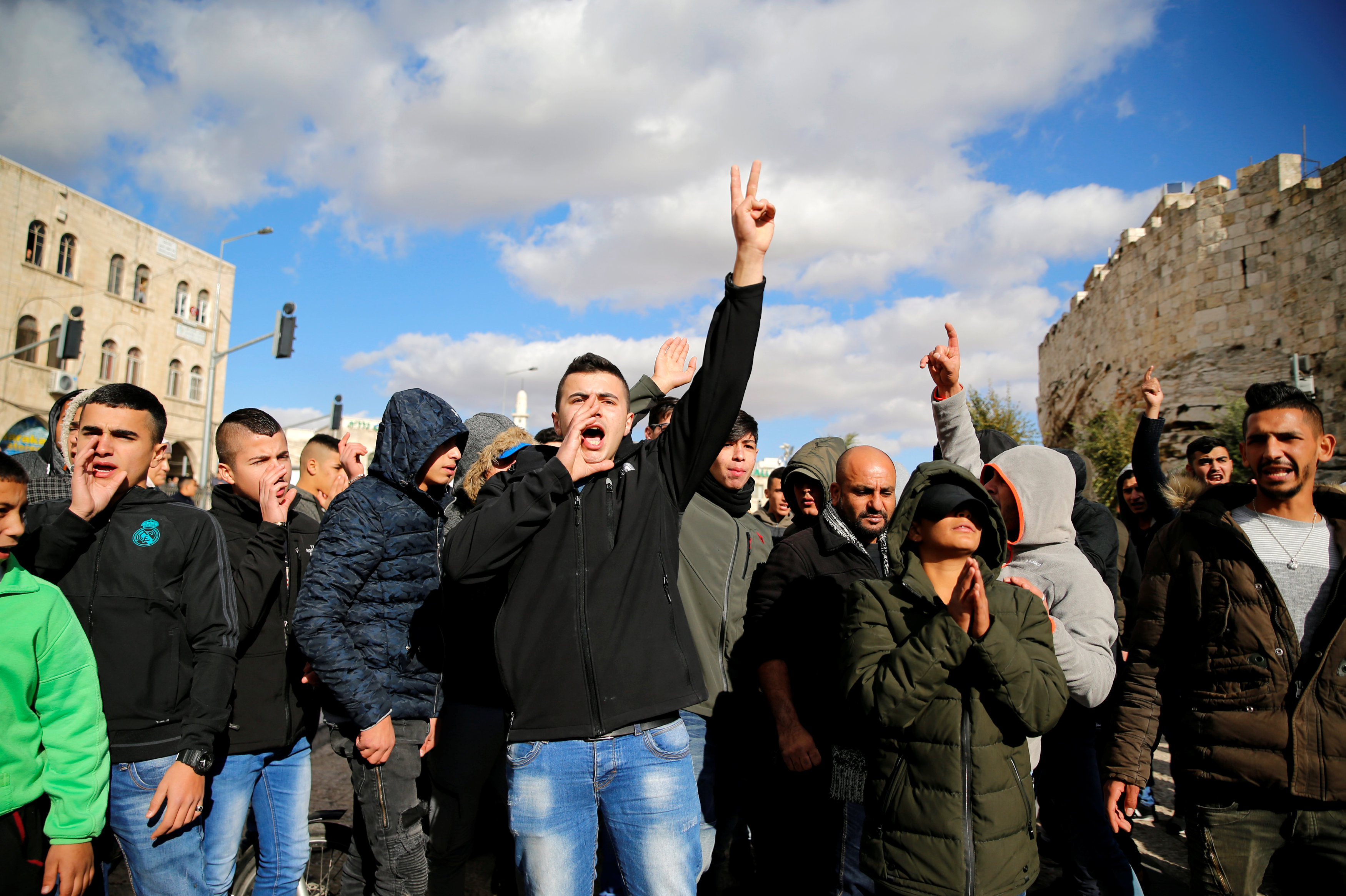 Palestinians shout slogans during a protest following U.S. President Donald Trump's announcement that he has recognized Jerusalem as Israel's capital, near Damascus Gate in Jerusalem's Old City December 7, 2017