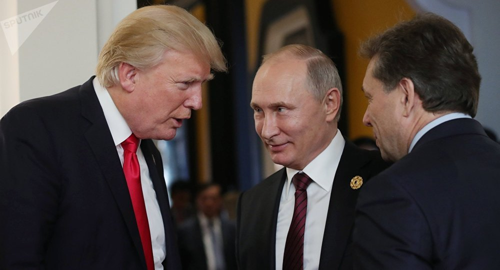 Russian President Vladimir Putin and US President Donald Trump, left, are seen here during a break in a working session at the Asia-Pacific Economic Cooperation Economic Leaders' Meeting