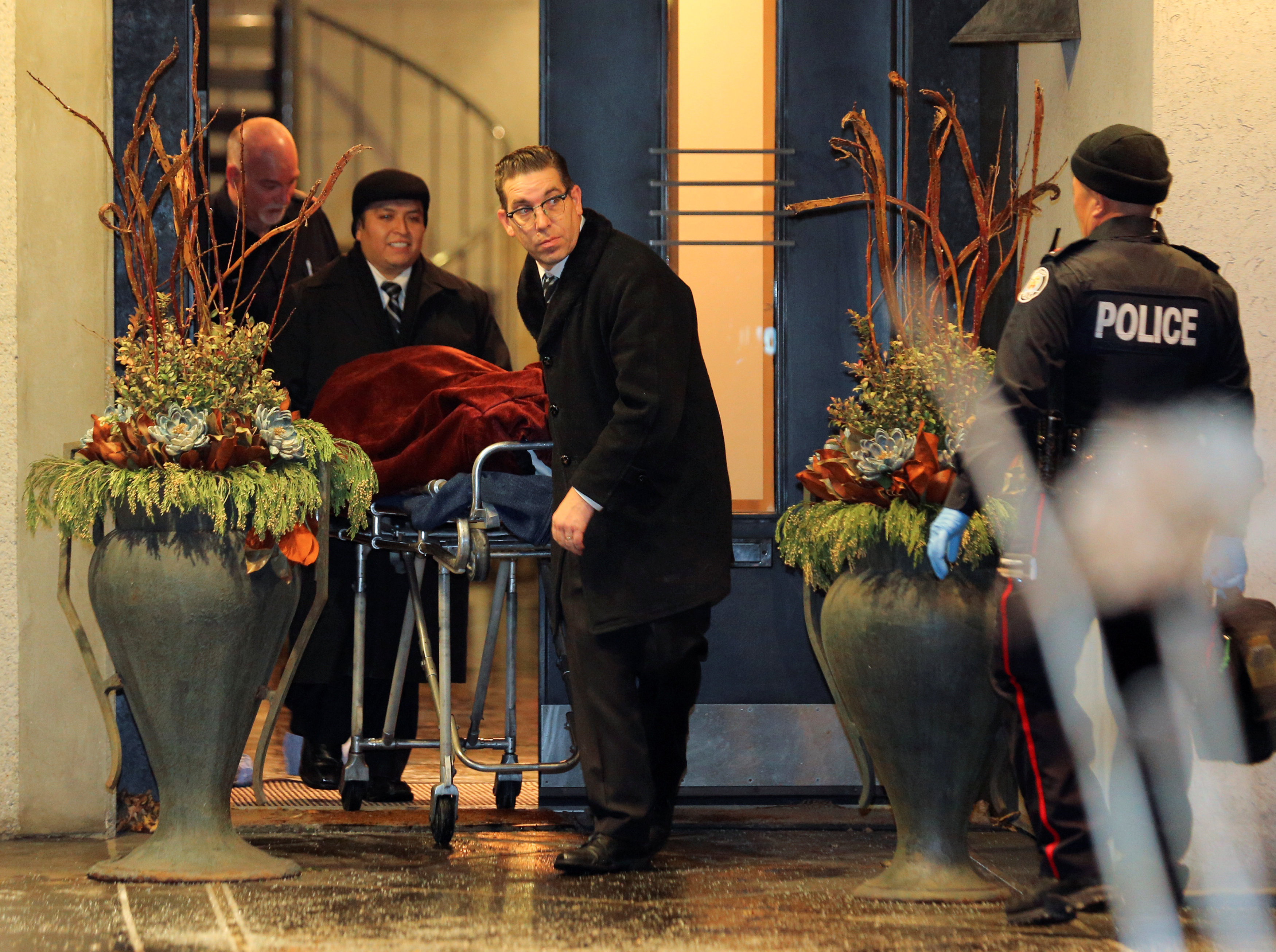 One of two bodies is removed from the home of billionaire founder of Canadian pharmaceutical firm Apotex Inc., Barry Sherman and his wife Honey, who were found dead under circumstances that police described as suspicious in Toronto, Ontario, Canada, December 15, 2017