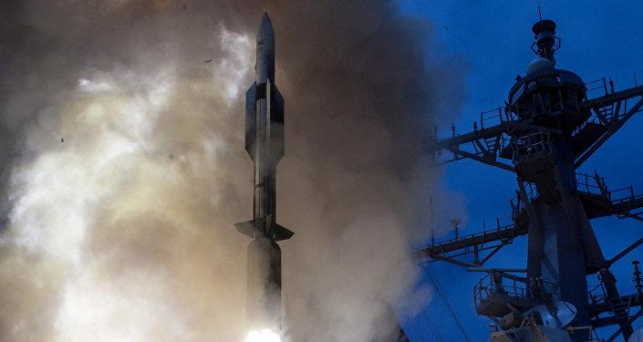 Launches a RIM-174 Standard ERAM (Standard Missile-6, SM-6)
