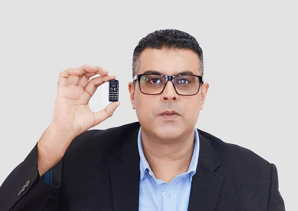 Shazad Talib holding one of his new Zanco Tiny T1 phones