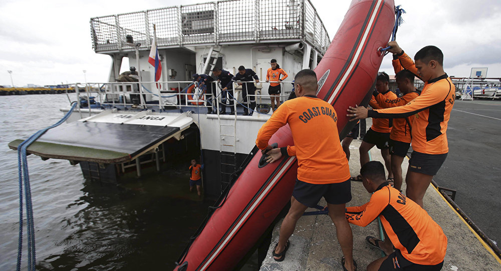 Four dead and seven missing as ferry capsizes during storm in Philippines