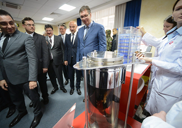 Deputy Russian Prime Minister Dmitry Rogozin, second left, visits the Advanced Research Foundation of the Roscosmos State Corporation for Space Activities