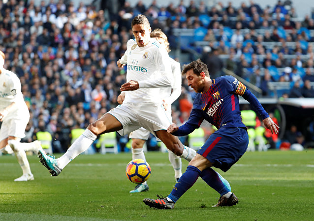 Soccer Football - La Liga Santander - Real Madrid vs FC Barcelona - Santiago Bernabeu, Madrid, Spain - December 23, 2017 Barcelona's Lionel Messi in action as Real Madrid's Raphael Varane attempts to block