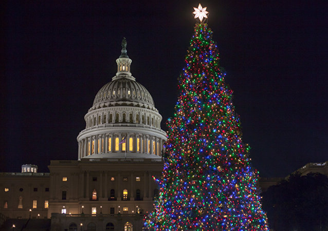 The Capitol Christmas tree is illuminated as lawmakers in the Senate work late into the evening on the Republican tax bill, in Washington, Tuesday, Dec. 19, 2017.
