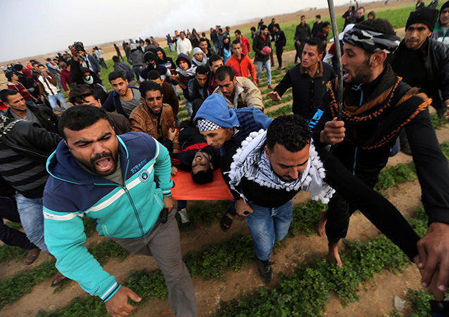 A wounded Palestinian demonstrator is evacuated during clashes with Israeli troops at a protest against U.S. President Donald Trump's decision to recognize Jerusalem as the capital of Israel, near the border with Israel in the southern Gaza Strip December 29, 2017