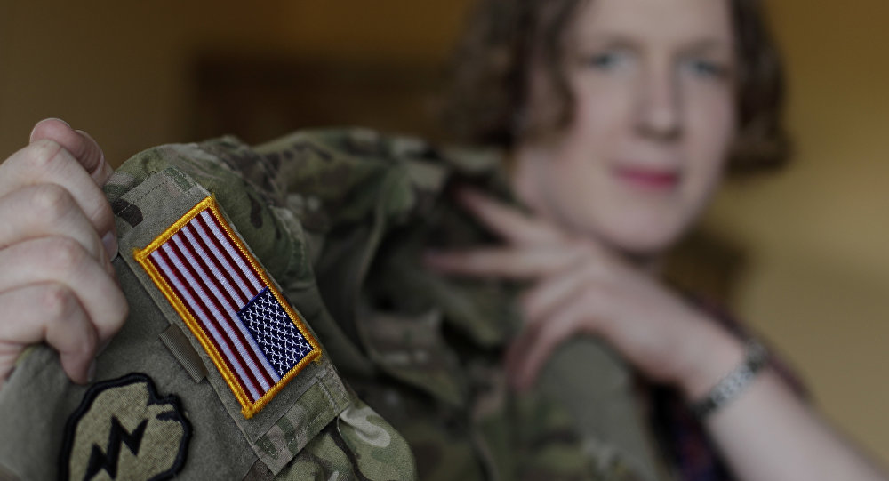 Transgender U.S. army captain Jennifer Sims lifts her uniform