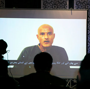Former Indian navy officer Kulbhushan Sudhir Jadhav is seen on a screen during a news conference at the Ministry of Foreign Affairs in Islamabad, Pakistan December 25, 2017
