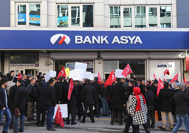 FILE PHOTO - People stage a protest against the seizure of the Islamic Bank Asya, in front of a Bank Asya branch in downtown Ankara on February 4, 2015