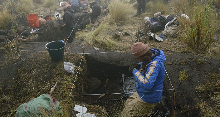 In this 2016 photo provided by Mexico's National Institute of Anthropology and History, INAH, researchers excavate a site on the shores of Nahualac Lagoon, at the foot of the Iztaccihuatl volcano in Mexico State, Mexico
