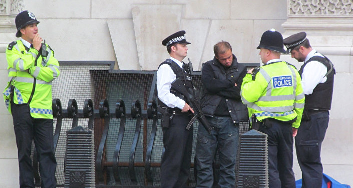 London police speak to homeless man