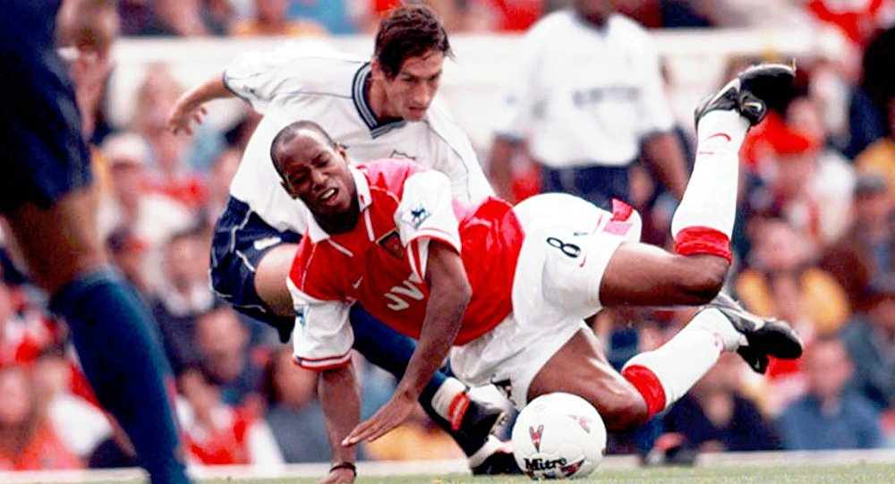 Arsenal's Ian Wright (8) is fouled by Justin Edinburgh of Tottenham Hotspur, during their FA Premier League match at Highbury, London Saturday Aug. 30, 1997