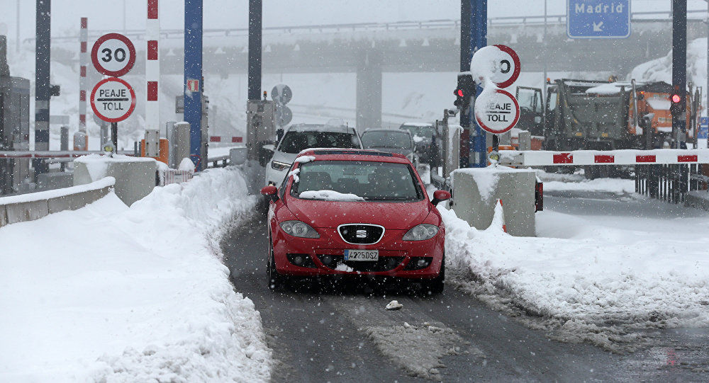 Some cars leave the AP6 motorway after being stuck for the night due to this winter's first heavy snowfall in Villacastin, Segovia province, Spain on January 7, 2018