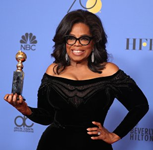 75th Golden Globe Awards – Photo Room – Beverly Hills, California, U.S., 07/01/2018 – Oprah Winfrey poses backstage with her Cecil B. DeMille Award