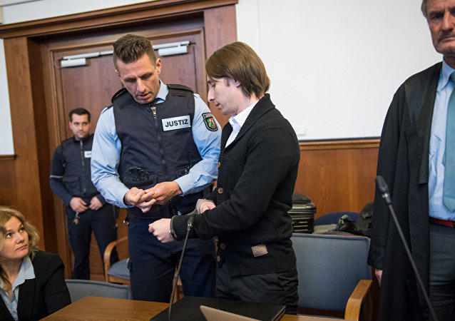 Sergej W., who is suspected of detonating three bombs, targeting the Borussia Dortmund soccer team bus in April, arrives to stand trial at a German state court in Dortmund, Germany, January 8, 2018