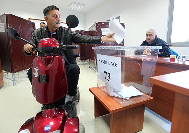 A Turkish Cypriot man casts his ballot for the parliamentary election at a polling station in the northern part of Nicosia in the self-proclaimed Turkish Republic of Northern Cyprus (TRNC), which is only recognized by Turkey, on January 7, 2018